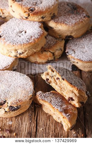 Traditional Welsh Cakes With Raisins And Powdered Sugar Macro. Vertical