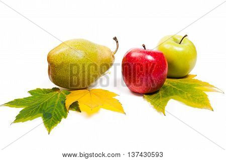 Group Of Ripe Juicy Fruit With Yellow Autumn Leafs On White Background. With Clipping Path.