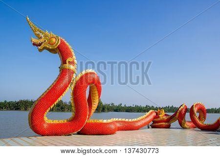 Red Big Naga Statue at Thailand. blue shy