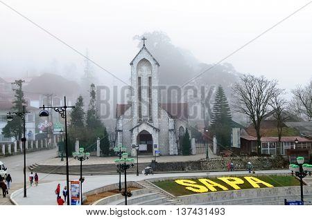 SAPA, VIETNAM, February 10, 2016 old church, town center of Sa Pa, Vietnam, morning fog