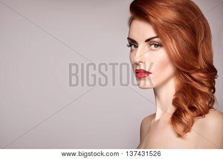 Fashion Natural Makeup. Beauty portrait nude woman. Redhead Model sexy girl, Hairstyle, fashion Makeup. Shiny wavy hair, fashion Eyelashes. Skincare Spa, fashion concept. Creative unusual.Redhead lady