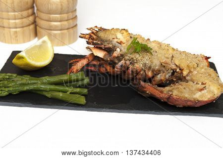 Lobster Thermidor A meal of half a Lobster Thermidor with Asparagus Spears