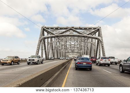 WESTLAKE USA - APR 15 2016: Traffic on the historic Calcasieu River iron bridge. City of Westlake Louisiana United States