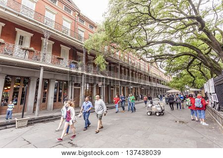 NEW ORLEANS LA USA - APR 16 2016: Street scenery in the traditional French Quarter in the city of New Orleans. Louisiana United States