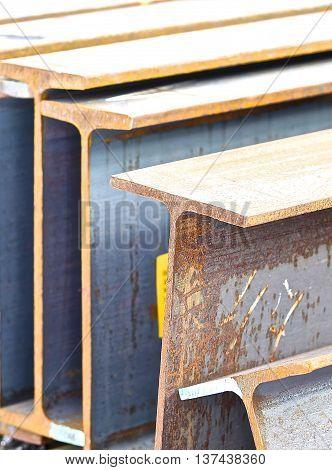 metal profile beam lies in bundles of stock