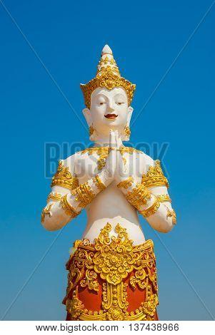 Thai graven image on blue sky background.