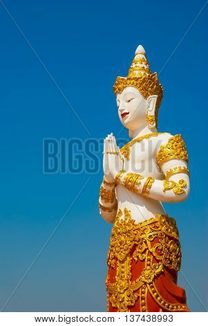 Thai graven image on blue sky background.