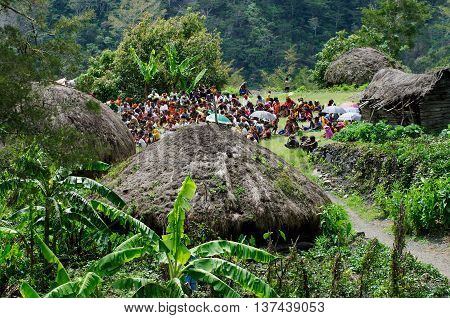 PAPUA PROVINCE INDONESIA--DECEMBER 31:Christian preaching in the Papuan village of Baliem Valley on New Guinea Island Indonesia on December 31 2010