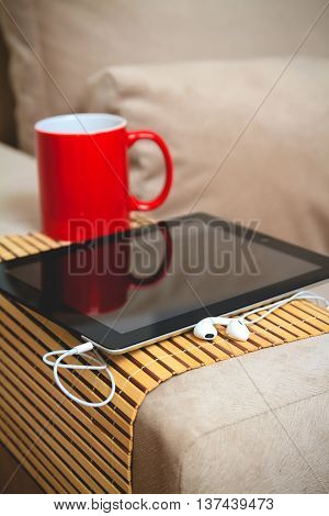 Coffee and plate on the arm of the sofa