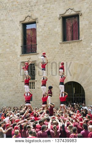 BARCELONA SPAIN - JUNE 26 2016: Castellers group of people that build human castles on June 26 2016 in Barcelona. Castles is a Human Tower traditional festivities in Catalonia Spain.