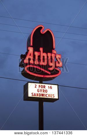 DALLAS TX USA - APR 17 2016: Arby's restaurant logo illuminated at night. Arby's is an international chain of fast food restaurants