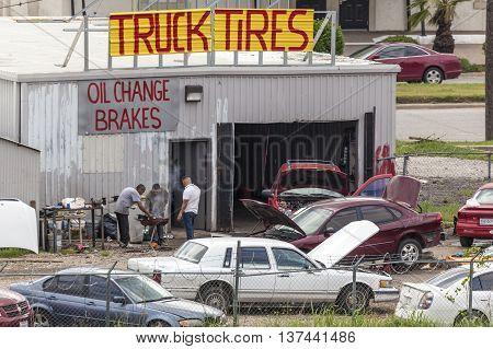 DALLAS TX USA - APR 18 2016: Car repair shop in Dallas. Mechanics have a barbecue in the backyard. Texas United States
