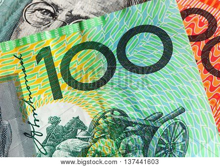 Closeup of two Australian banknotes the one hundred and twenty dollar notes.