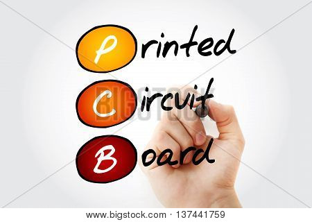 Hand writing PCB Printed Circuit Board with marker acronym business concept
