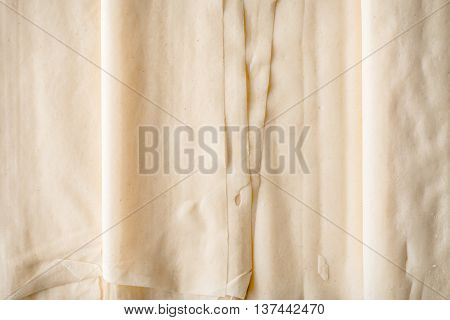 Filo dough sheets background close-up preparation, horizontal