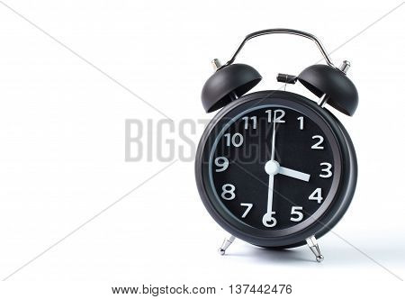 Black double bell alarm clock showing half past three on white background