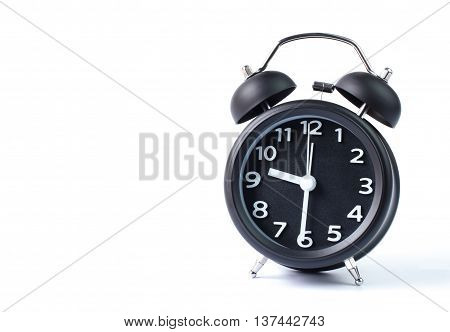Black double bell alarm clock showing half past nine on white background