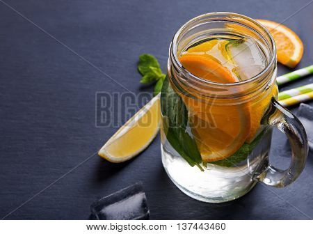 Lemonade In A Glass Jar On The Black Background