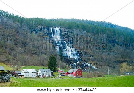 Waterfall And Home
