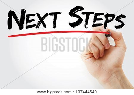 Hand Writing Next Steps With Marker