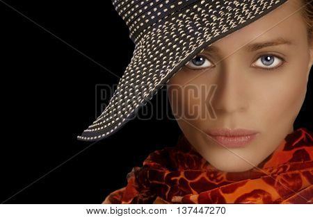 Gorgeous Fashion Model with Hat On Black