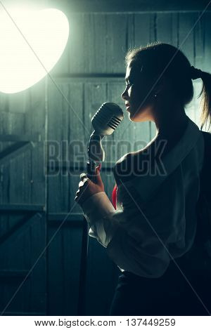 Sensual Woman With Microphone