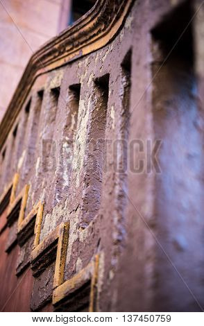An old cement railing with soft focus foreground and background that showcases a beautiful pattern.