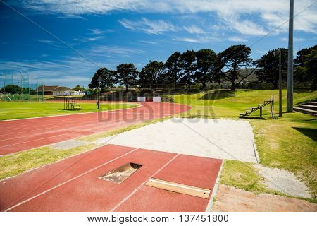 Long jump sand pit on running track in stadium