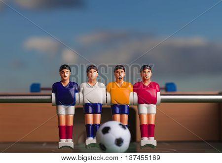 foosball table soccer football players blue sky