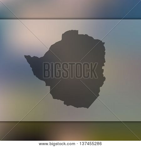 Blurred background with silhouette of Zimbabwe. Zimbabwe map.