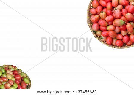 isolated bulk of ripening tomato in bamboo basket