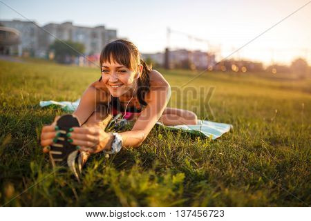 Athletic Woman Stretching Her Hamstring, Legs Exercise Training Fitness Before Workout Outside With