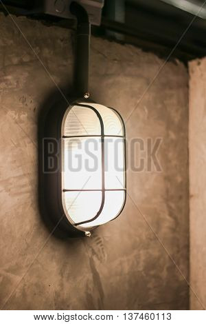 Decorative antique edison style filament light bulb outside at night