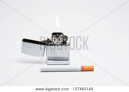 Cigarette and lighter on white. Isolated photo of an object with white background