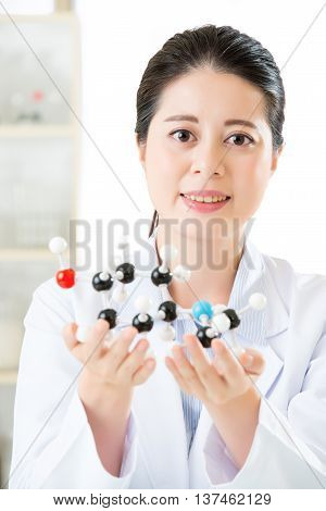 Asian Female Scientist Looking At Molecular Model Doing The Science Research
