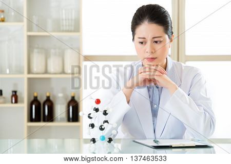 Asian Female Chemist Distressed Chemical Formula On Clipboard