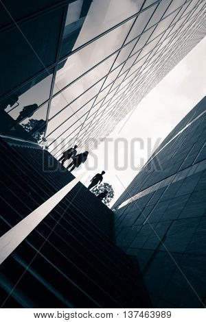 Street photography in Tokyo, detail of the architecture and silhouettes figure in the Ginza business district.