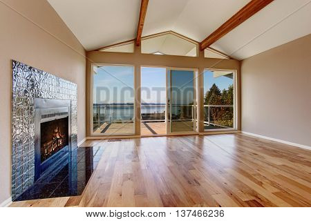 Empty Room Interior With Hardwood Floor, Vaulted Ceiling And Fireplace