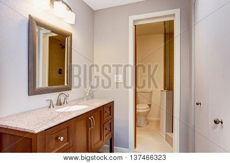 Modern Bathroom With Vanity Cabinet, Granite Counter Top And Mirror.