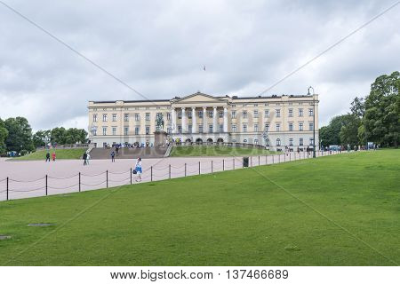 OSLO, NORWAY - JULY 1: Tourists enjoying the beautiful weather visit the Royal Palace on July 1, 2016 in Oslo, Norway.