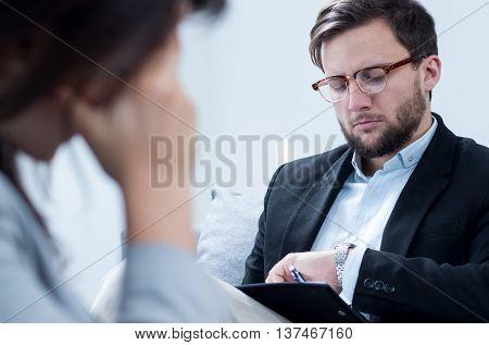 Psychologist In Suit With Patient
