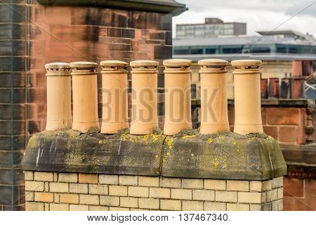 Chimney stack with Victorian style clay pots in Glasgow Scotland.