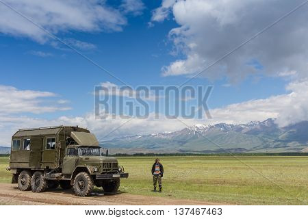 Russian truck Ural crossing a small river in Altay