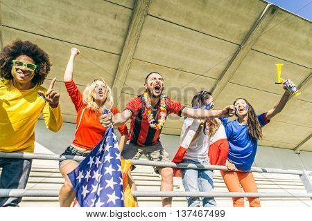 Football fans supporting teams at the arena