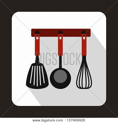 Spatula, ladle and whisk, kitchen tools on a hanger icon in flat style on a white background