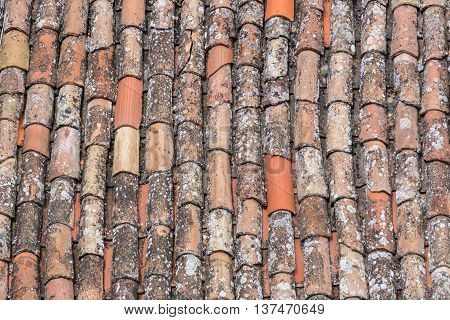 Close up from an old red and orange colored  roof