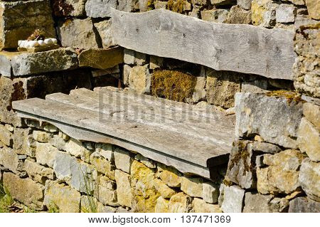 Close up from Wodden bench in a wall