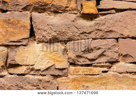 Close up from orange colored Old brickwall