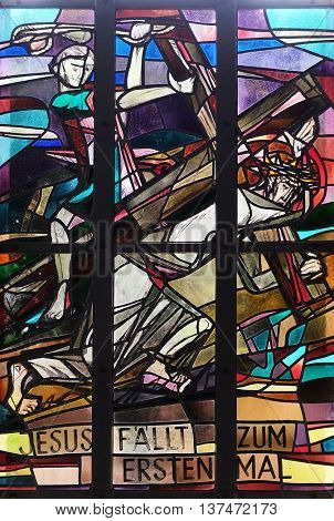 KLEINOSTHEIM, GERMANY - JUNE 08: 3rd Stations of the Cross, Jesus falls the first time, stained glass window in Saint Lawrence church in Kleinostheim, Germany on June 08, 2015.
