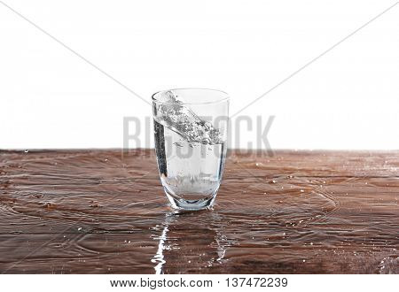 Filled glass of water on wooden table